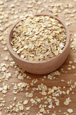 Rolled oats in a wooden bowl — Stock Photo