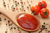Tomato sauce in a wooden spoon — Stock Photo