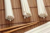 Udon noodles and chopsticks on bamboo napkin  — Stock Photo