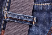 Close-up of blue jeans with belt — Stock Photo
