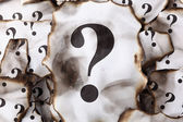 Burnt Question Marks — Stock Photo