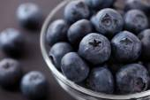 Fresh blueberries in a glass bowl — Stock Photo