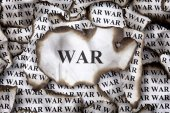 Burnt pieces of paper with the word War — Stock Photo