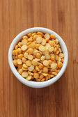 Split yellow peas in a bowl — Stock Photo