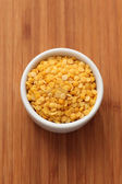 Yellow split lentils in a bowl — Stock Photo