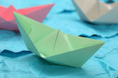 Paper boats in the paper ocean — Stock Photo