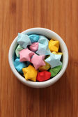 Colorful origami lucky stars in a bowl — Stock Photo