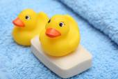 Rubber Ducks on the soft towel and soap — Stock Photo