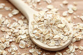 Rolled oats in the wooden spoon — Stock Photo