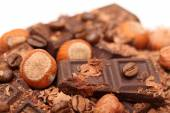 Pieces of chocolate with hazelnuts and coffee beans — Stock Photo