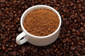Cup of coffee granules — Stock Photo