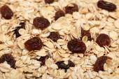 Oat flakes with raisins — Stock Photo