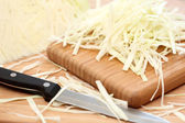 Shredded cabbage on cutting board — Stok fotoğraf