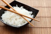 Bowl of rice with chopsticks — Stock Photo