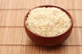Brown rice in bowl — Stock Photo