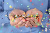 Blowing confetti — Stock Photo