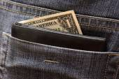 One dollar in the back pocket — Stock Photo