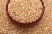 Wheat groats in bowl — Stock Photo