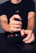 Gamer playing video game with retro joystick — Stock Photo