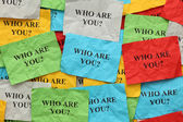 """Crumpled colorful paper notes with the question """"Who are you?"""" — Stock Photo"""