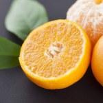 Fresh mandarines and green leaves — Stock Photo #65363329