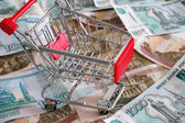 Shopping cart on russian rubles — Stock Photo