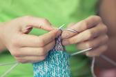 Woman knitting socks — Stock Photo