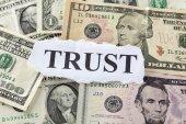 "Word ""Trust"" on Dollar Bills — Stock Photo"