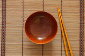 Empty wooden bowl and chopsticks — Stock Photo