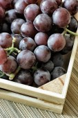 Red grapes bunch into box — Stock Photo