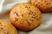 Bun with flax and sesame seeds — Stok fotoğraf