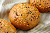 Bun with flax and sesame seeds — Stock Photo