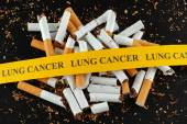 Broken cigarette with message Lung Cancer — Stock Photo