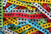 Colorful pieces of paper with hearts — Stock Photo
