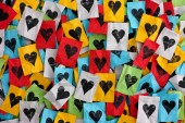 Crumpled colorful pieces of paper with hearts — Stock Photo