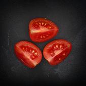 Three halves of cherry tomato — Stock Photo