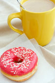 Donut and coffee cup — Stock Photo