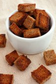 Rye homemade croutons in a white bowl — Stock Photo