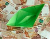Green paper boat on five thousand rubles banknotes — Stock Photo