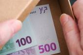 Hands open box with Euro banknotes in it — Stock Photo