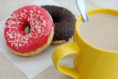 Donuts and coffee cup with milk — Stock Photo