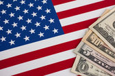 American flag and dollars — Stock Photo