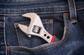 Adjustable wrench in a jeans pocket — Stock Photo
