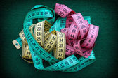 Colorful measuring tapes pile — Stock Photo