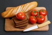 Fresh tomato and bread — Stock Photo