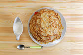 Frying homemade pancakes with sour cream — Stock Photo