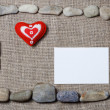 Heart and blank note card framed by stones — Stock Photo #78027656