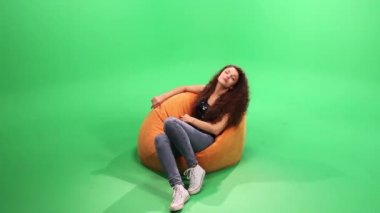 Girl relax on the bean bag. touch it and smile — Stock Video