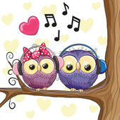 Two owls with headphones — Stock Vector
