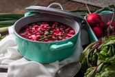 Beetroot soup with chives and radishes — Stock Photo